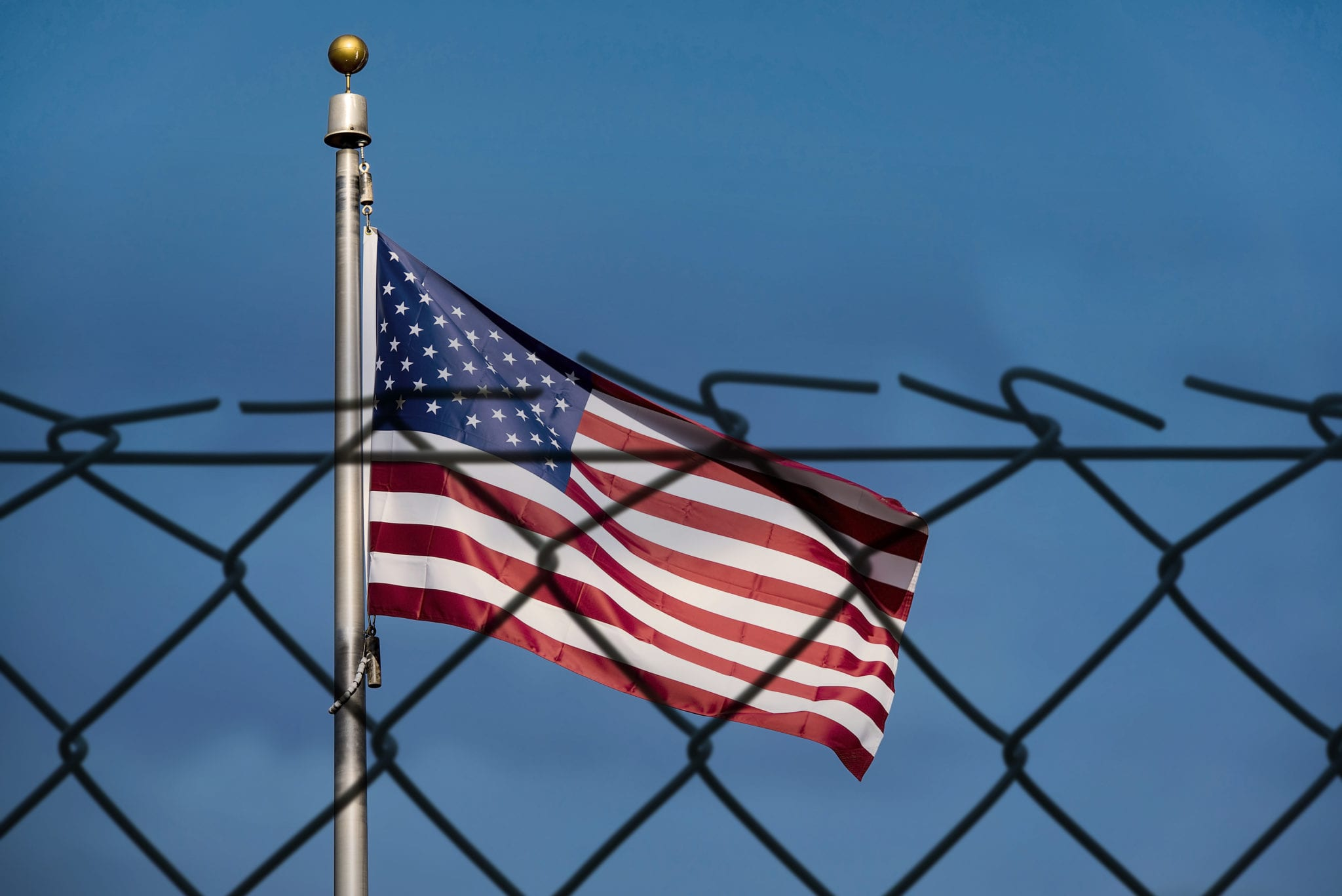 American flag and defocused fence